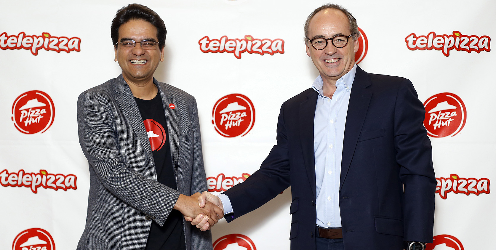 Milind Pant, presidente de Pizza Hut International, y Pablo Juantegui, presidente ejecutivo y CEO de Telepizza.