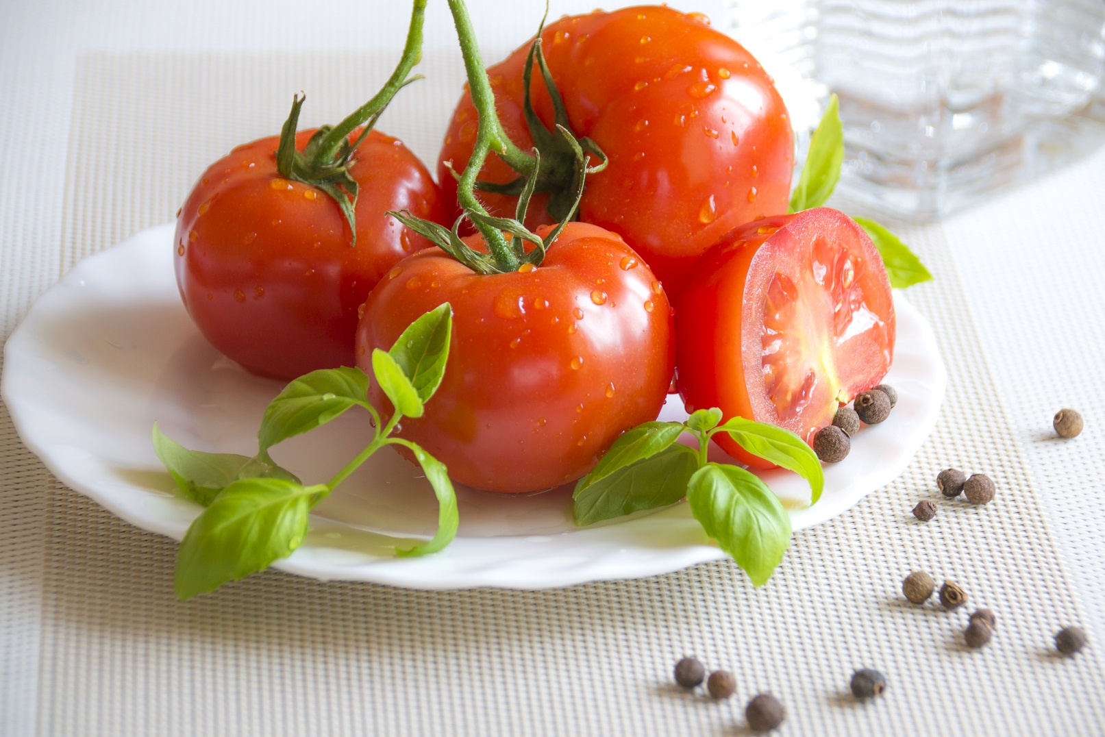 fresh and juicy tomatoes with basil leaves